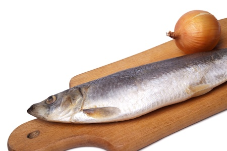 fishery products: Herring and onion on kitchen board. Isolated on white background.