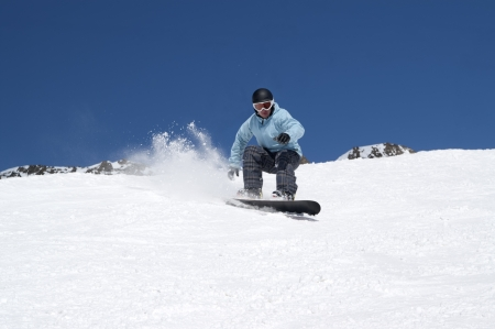Snowboarding in snowy mountains Stock Photo