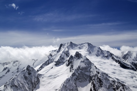 High mountains in cloud. Caucasus. Dombay. photo