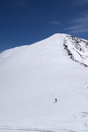 Freeriders on top of mountains. Caucasus Mountains, ski resort Dombay, Mount Musa Achitara photo