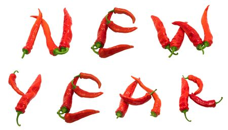 New year text composed of red chili peppers. Isolated on white background. photo