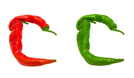 Letters C composed of green and red chili peppers. Isolated on white background photo