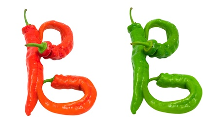 Letters B composed of green and red chili peppers. Isolated on white background photo