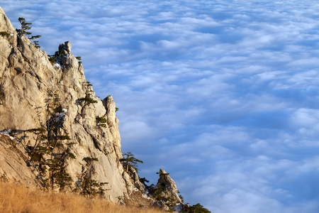 Sunlit cliffs and sea in clouds. Crimean mountains. photo