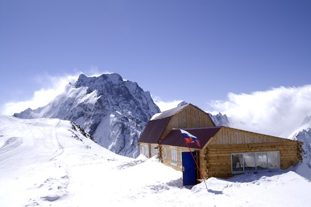 Wooden houses in high mountains. Ski resort Dombay, Caucasus Mountains.