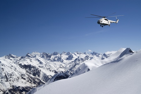 heli: Helicopter in snowy mountains
