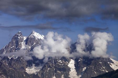 Mt  Ushba in clouds, Caucasus Mountains, Georgia, Svaneti  photo