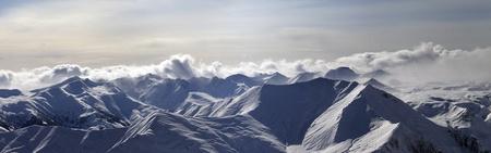Panorama of evening mountains. Caucasus Mountains, Georgia, Gudauri. Stock Photo