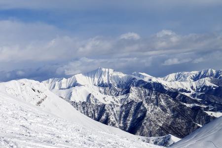 Ski slope and snowy mountains  Caucasus Mountains, Georgia, ski resort Gudauri  photo