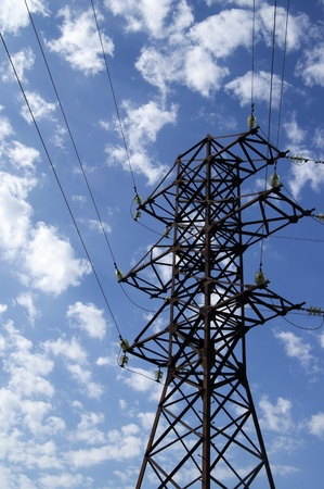 Power transmission line against blue sky with clouds Stock Photo - 13340658