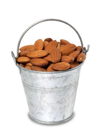 Tin bucket with almonds  Isolated on white background  photo