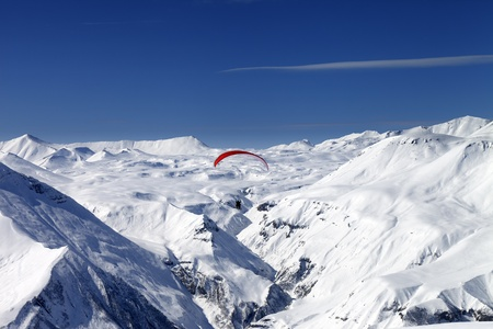 Sky gliding in snowy mountains  Caucasus, Georgia, ski resort Gudauri  photo