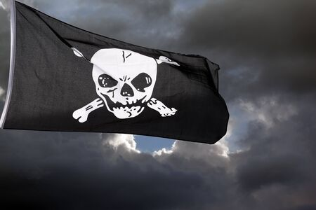 Jolly Roger (pirate flag) against storm clouds Stock Photo - 14122005