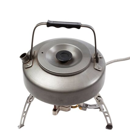 Camping gas stove and teapot  Isolated on white background photo