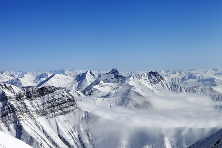 capped: Snowy mountains in haze  Caucasus Mountains, Georgia  Stock Photo