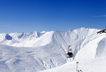 Skiers on ropeway at ski resort Gudauri  Georgia, Caucasus Mountains  photo