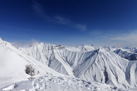 Winter mountains and blue sky. Caucasus Mountains, Georgia, ski resort Gudauri. photo