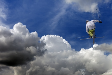 Freestyle ski jumper with crossed skis Stock Photo - 15680700