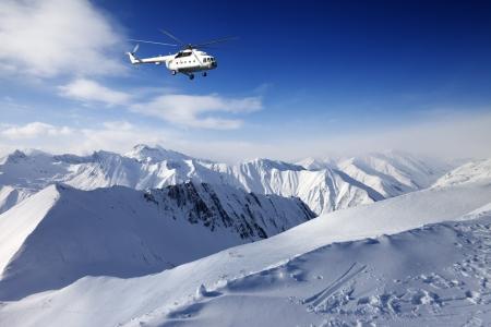 Heliski in snowy mountains Stock Photo