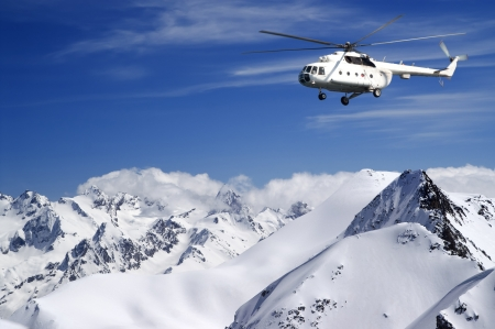 Helicopter in winter mountains Stock Photo