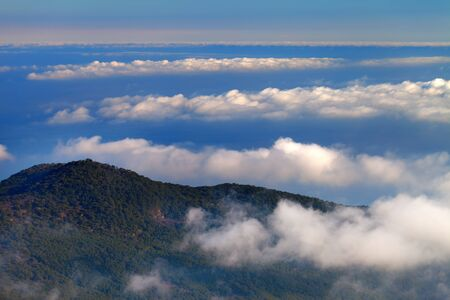 Hill and sea in clouds Stock Photo - 16468331