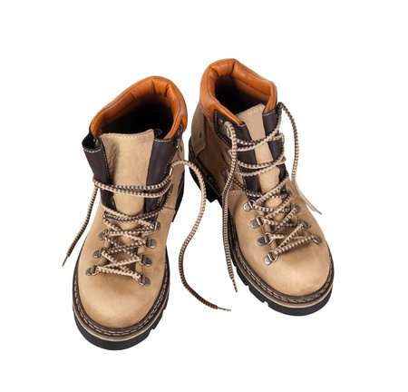 Pair of hiking boots isolated on white background. Top view. photo