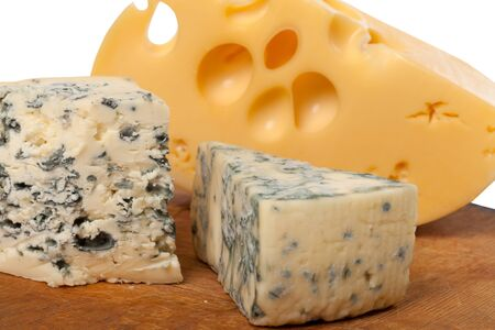 chees: Dorblu and other cheeses on old wooden board