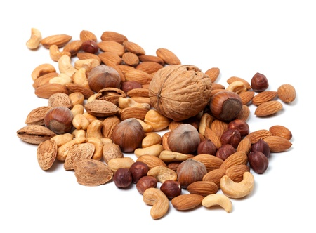 cobnut: Assortment of raw and roasted nuts on white background