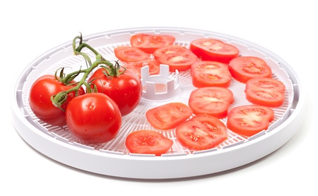 Fresh tomato prepared to dehydrated  On white background  photo