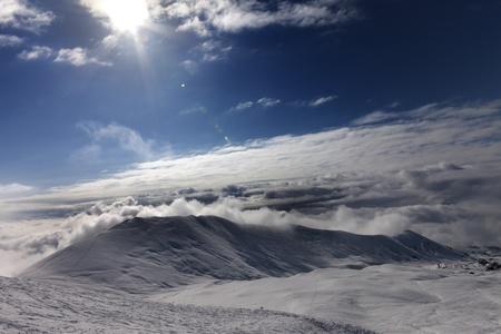 offpiste: Off-piste slope in clouds  Caucasus Mountains, Georgia, ski resort Gudauri