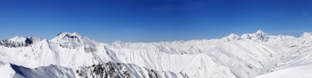 Panorama of snow winter mountains  Caucasus Mountains, Georgia, view from ski resort Gudauri  photo