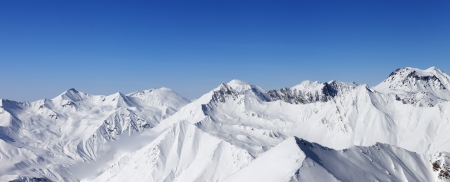 Panorama of snow mountains and blue sky  Caucasus Mountains, Georgia, view from ski resort Gudauri