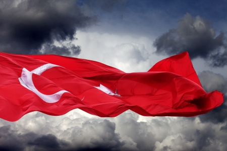 Waving flag of Turkey against storm clouds Stock Photo
