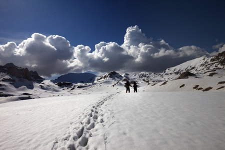 Hikers on snow plateau. Turkey, Central Taurus Mountains, Aladaglar (Anti-Taurus), plateau Edigel (Yedi Goller) photo