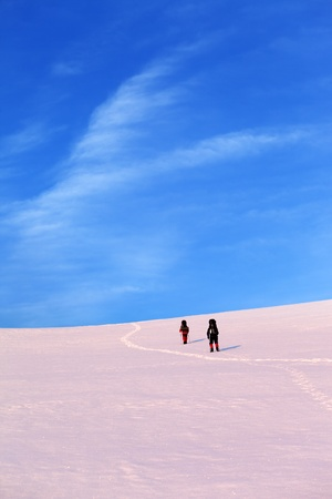 Two hikers on sunrise snow plateau. Turkey, Central Taurus Mountains, Aladaglar (Anti-Taurus) plateau Edigel (Yedi Goller) photo