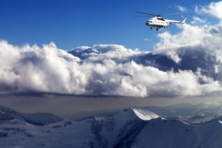 Helicopter in winter mountains photo