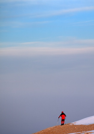 Hiker on edge of cliff in sunrise. Turkey, Central Taurus Mountains Aladaglar (Anti-Taurus). photo