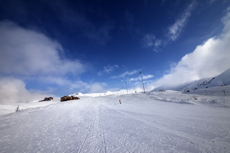 Snowboarder on piste slope in nice day. Georgia, ski resort Gudauri. Caucasus Mountains. Stock Photo - 21399401