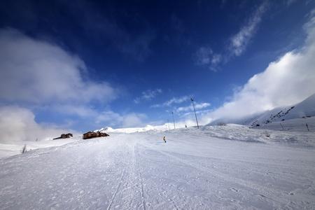 extreme angle: Snowboarder on piste slope in nice day. Georgia, ski resort Gudauri. Caucasus Mountains.