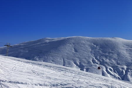 offpiste: Gondola lift and off-piste slope. Ski resort Gudauri. Caucasus Mountains, Georgia.