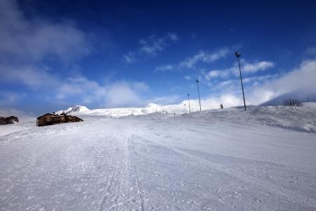 Ski slope and hotel in winter mountains. Georgia, ski resort Gudauri. Caucasus Mountains.