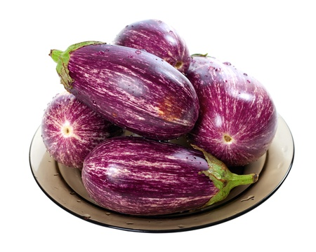 brinjal: Eggplants on round plate isolated on white background.