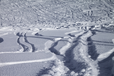 Background of off-piste ski slope, new-fallen snow photo