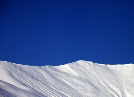 offpiste: Off-piste slope and blue clear sky in nice winter day. Stock Photo