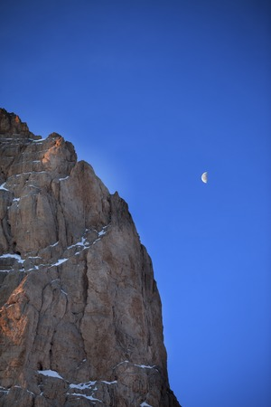 Rocks at early morning and blue sky with moon.  photo