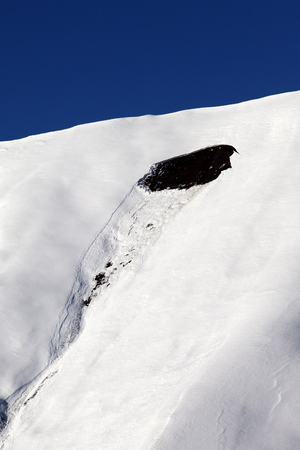 off piste: Trace of avalanche on off piste slope in sun day.