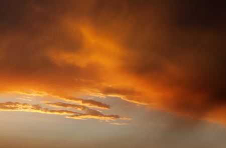 Fiery sunrise sky on summer sea photo