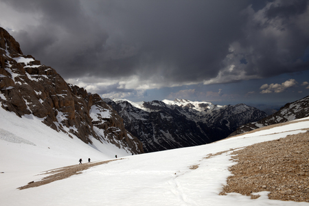 Group of hikers in snowy mountains before storm. Turkey, Central Taurus Mountains, Aladaglar (Anti Taurus). Wide-angle view.  photo