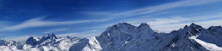 Panorama of winter mountains. Caucasus Mountains. View from ski slope mt. Elbrus. photo