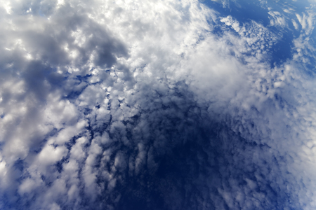 Sky with clouds in windy day. Wide-angle view. photo